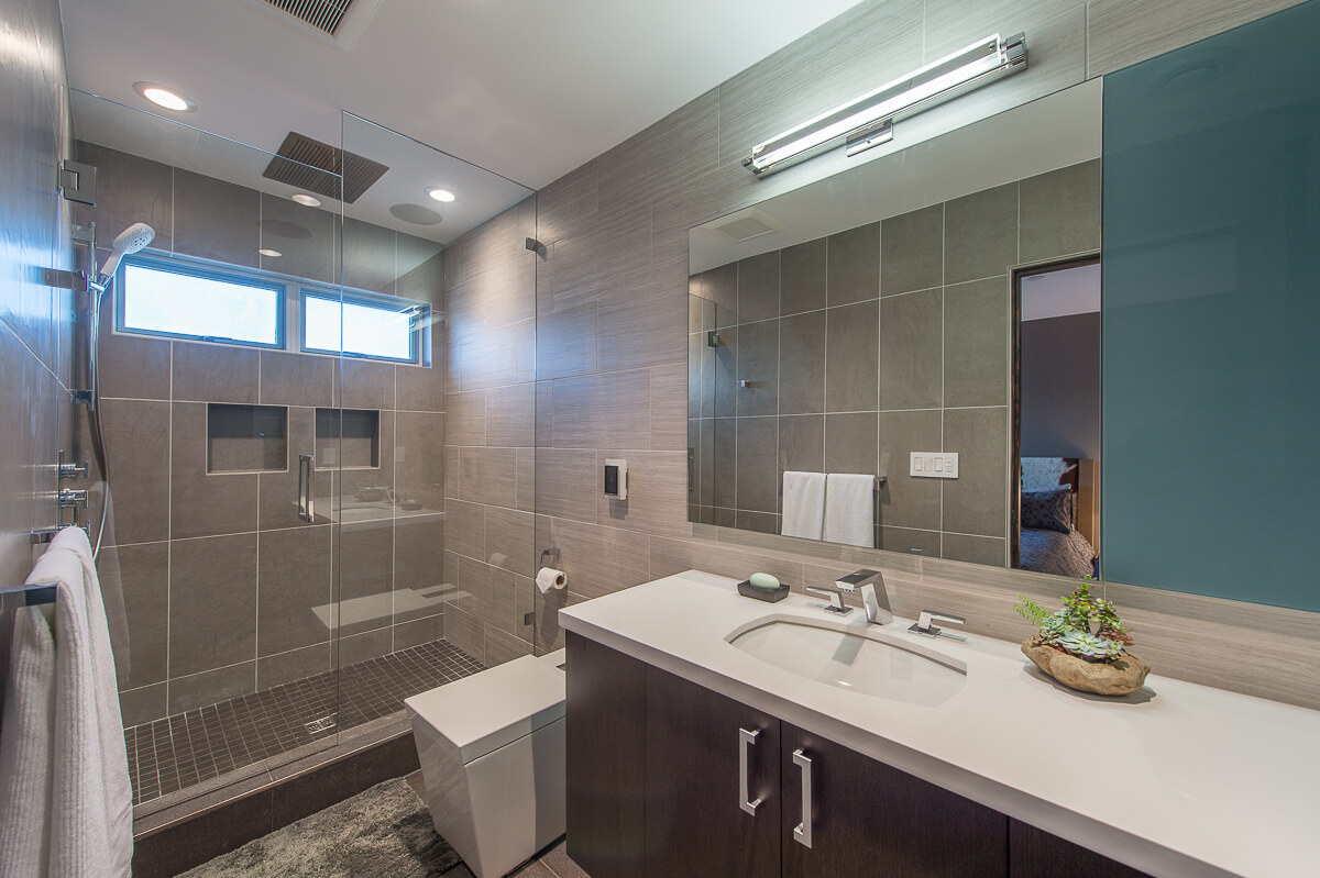 After - By reconfiguring 3 small rooms; a 2nd master suite with a walk-in closet and bathroom was completed.