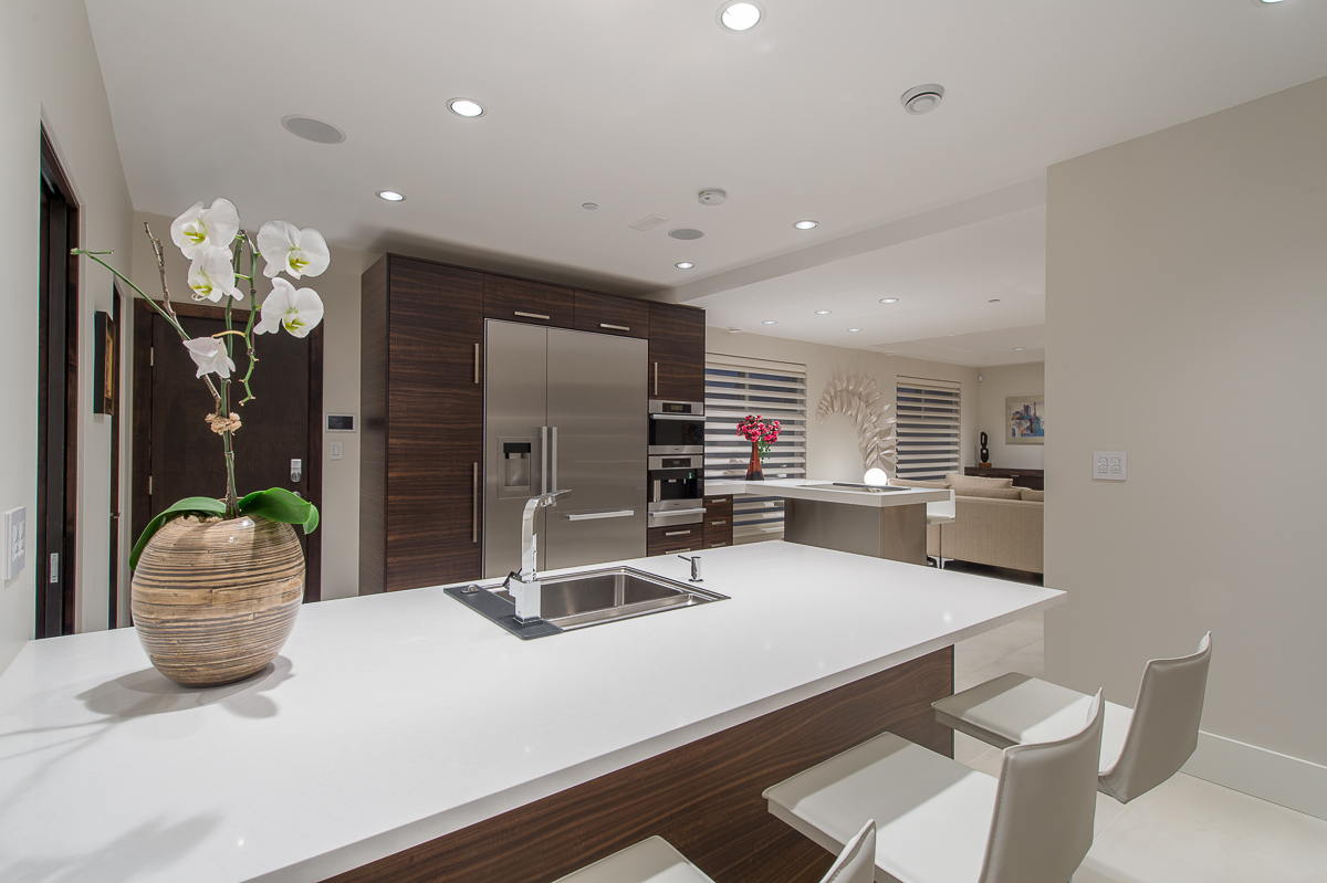 After - Installation of tile flooring and dark stained wood cabinetry created a modern sophisticated look.